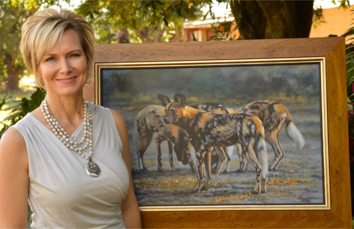ILSE with a painting of dappled dogs